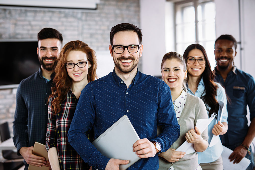 group of business people smiling at successful Decisions workflow deployment