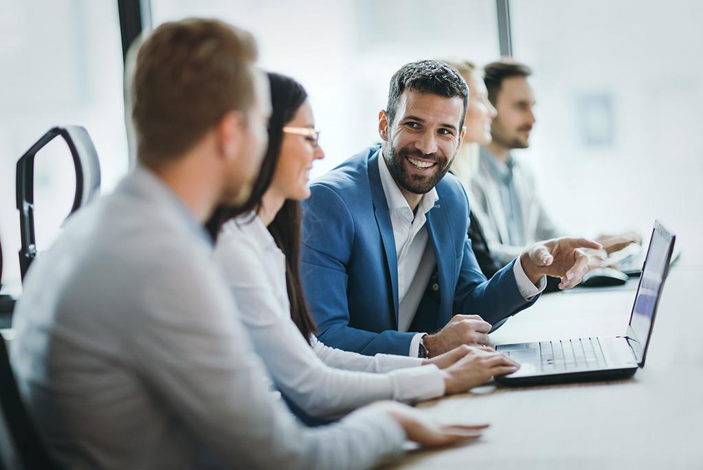 business management at a table discuss business process management (bpm)